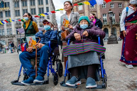 Two very old Tibetan people are listening the speeches, during the Dalai Lama 86th birthday celebration in Amsterdam, on July 6th, 2021.