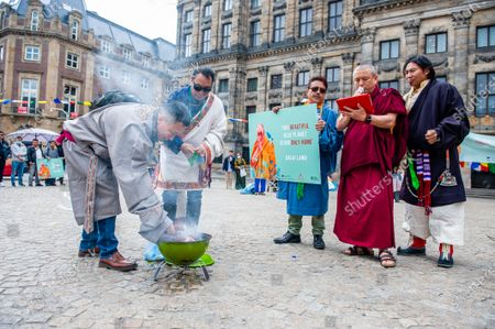 A Tibetan monk is carried out a  Sangsol ceremony, during the Dalai Lama 86th birthday celebration in Amsterdam, on July 6th, 2021.