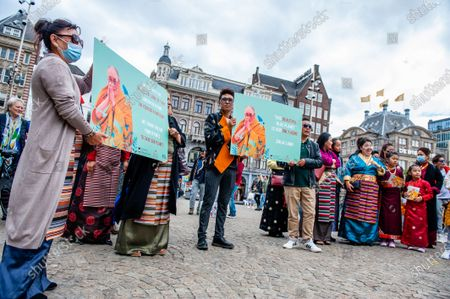 Several Tibetan people are holding placards with the Dalai Lama portrait on them, during the Dalai Lama 86th birthday celebration in Amsterdam, on July 6th, 2021.