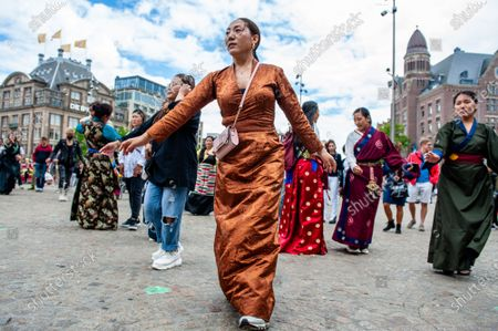 Tibetan people are dancing traditional Tibetan music, during the Dalai Lama 86th birthday celebration in Amsterdam, on July 6th, 2021.