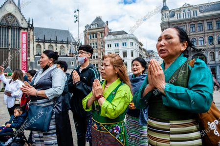 Tibetan people gathered at the Dam Square is praying, during the Dalai Lama 86th birthday celebration in Amsterdam, on July 6th, 2021.