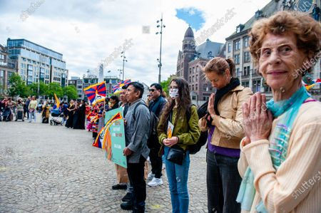People gathered at the Dam Square is praying, during the Dalai Lama 86th birthday celebration in Amsterdam, on July 6th, 2021.