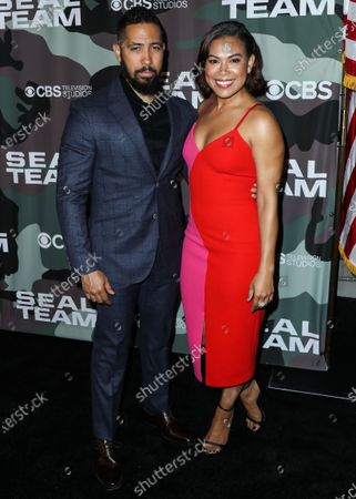 Neil Brown Jr. and Toni Trucks arrive at the Los Angeles Premiere Of CBS Television Studios' 'SEAL Team' held at ArcLight Cinemas Hollywood on February 25, 2020 in Hollywood, Los Angeles, California, United States.