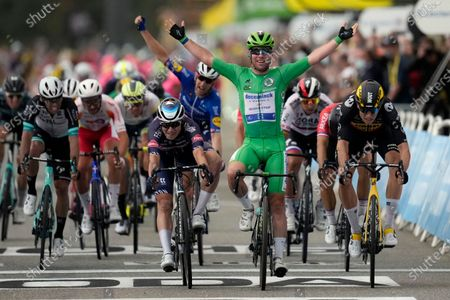 Britain's Mark Cavendish, wearing the best sprinter's green jersey, celebrates with teammate in background Denmark's Michael Morkov, as he crosses the finish line to win the tenth stage of the Tour de France cycling race over 190.7 kilometers (118.5 miles) with start in Albertville and finish in Valence, France