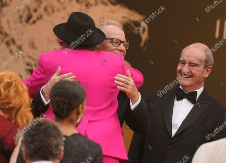 Jury president Spike Lee embraces Festival director Thierry Fremaux as Festival president Pierre Lescure looks on at the premiere of the film 'Annette' and the opening ceremony of the 74th international film festival, Cannes, southern France