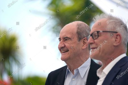 Festival president Pierre Lescure, left, and Festival director Thierry Fremaux pose for photographers at a photo call for Jodie Foster. Foster will receive an honorary Palme d'Or during the opening ceremony for the 74th international film festival, Cannes, southern France