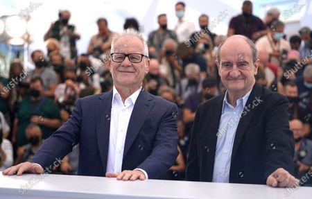Festival director Thierry Fremaux, left, and Festival president Pierre Lescure attend a photo call for Jodie Foster. Foster will receive an honorary Palme d'Or during the opening ceremony at the 74th international film festival, Cannes, southern France