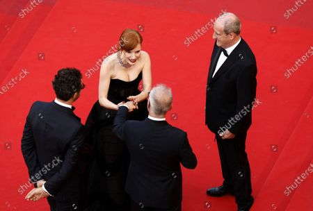 Jessica Chastain (C) is greeted by Cannes Film Festival General Delegate Thierry Fremaux (front, C) and Cannes Film Festival President Pierre Lescure (R) as she arrives for the screening of 'Annette' and the Opening Ceremony of the 74th annual Cannes Film Festival, in Cannes, France, 06 July 2021. Presented in competition, the movie opens the festival which runs from 06 to 17 July.