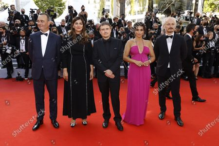 Stock Photo of Critics' Week Jury members , Michel Merkt, Didar Domehri, Jury President Cristian Mungiu, Camelia Jordana, and Karel Och arrive for the screening of 'Annette' and the Opening Ceremony of the 74th annual Cannes Film Festival, in Cannes, France, 06 July 2021. Presented in competition, the movie opens the festival which runs from 06 to 17 July.