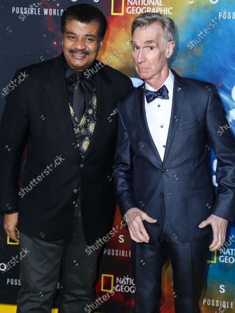 Astrophysicist Neil deGrasse Tyson and television presenter Bill Nye arrive at the Los Angeles Premiere Of National Geographic's 'Cosmos: Possible Worlds' held at Royce Hall at the University of California, Los Angeles (UCLA) on February 26, 2020 in Westwood, Los Angeles, California, United States.