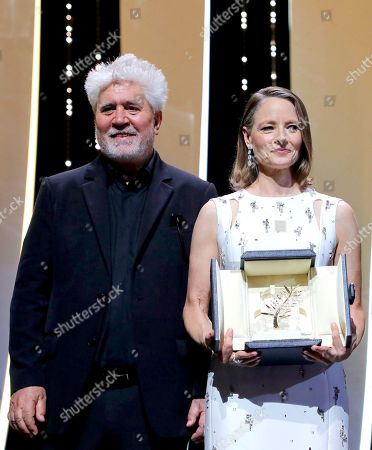 Pedro Almodovar, left, presents Jodi Foster with an honorary Palme d'Or at the opening ceremony of the 74th international film festival, Cannes, southern France