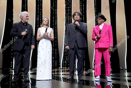 Pedro Almodovar, from left, Jodie Foster, Bong Joon Ho and jury president Spike Lee appear at the opening ceremony of the 74th international film festival, Cannes, southern France