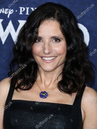 Actress Julia Louis-Dreyfus wearing an Emilia Wickstead dress with Irene Neuwirth jewelry arrives at the World Premiere Of Disney And Pixar's 'Onward' held at the El Capitan Theatre on February 18, 2020 in Hollywood, Los Angeles, California, United States.