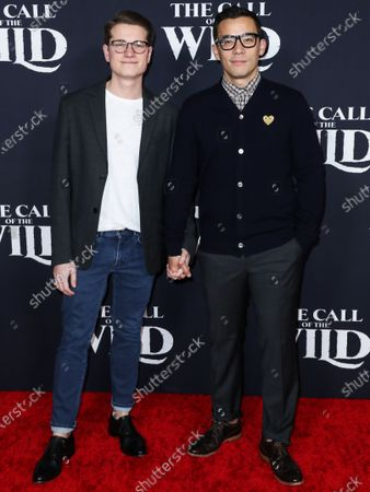 Joshua Cockream and Conrad Ricamora arrive at the World Premiere Of 20th Century Studios' 'The Call Of The Wild' held at the El Capitan Theatre on February 13, 2020 in Hollywood, Los Angeles, California, United States.