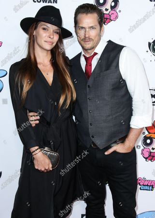 Liz Godwin and Jason Lewis arrive at the 2020 Christian Cowan x Powerpuff Girls Runway Show Season II held at NeueHouse Los Angeles on March 8, 2020 in Hollywood, Los Angeles, California, United States.