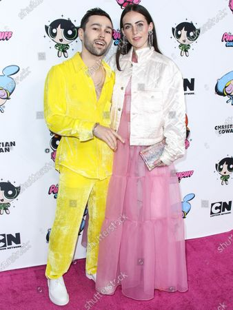 Max Schneider and Emily Cannon arrive at the 2020 Christian Cowan x Powerpuff Girls Runway Show Season II held at NeueHouse Los Angeles on March 8, 2020 in Hollywood, Los Angeles, California, United States.