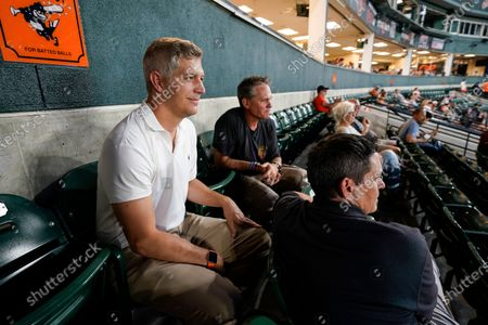 Baltimore Orioles general manager Mike Elias, left, and assistant general manager Sig Mejdal, right, sit with former Houston Astros second baseman Craig Biggio, center, as they watch the fifth inning of a baseball game between the Orioles and the Toronto Blue Jays, in Baltimore. Biggio's son, Cavan Biggio, plays third base for the Blue Jays