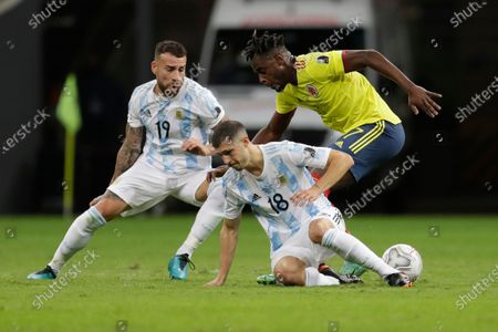 Argentina's Guido Rodriguez, below, and Nicolas Otamendi, left, fight for the ball with Colombia's Duvan Zapata during a Copa America semifinal soccer match at the National stadium in Brasilia, Brazil