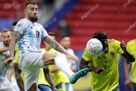 Argentina's Nicolas Otamendi (L) in action against Colombia's Duvan Zapata (R) during the Copa America semifinal soccer match between Argentina and Colombia at Mane Garrincha stadium in Brasilia, Brazil, 06 July 2021.