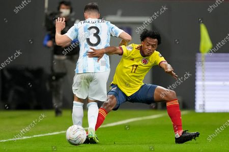 Colombia's Juan Cuadrado, right, and Argentina's Nicolas Tagliafico battle for the ball during a Copa America semifinal soccer match at the National stadium in Brasilia, Brazil