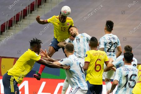 Colombia's Yerry Mina connects a header over Argentina's Nicolas Otamendi during a Copa America semifinal soccer match at the National stadium in Brasilia, Brazil