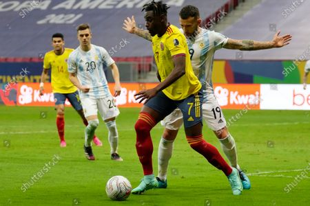 Stock Image of Argentina's Nicolas Otamendi challenges Colombia's Duvan Zapata during a Copa America semifinal soccer match at the National stadium in Brasilia, Brazil