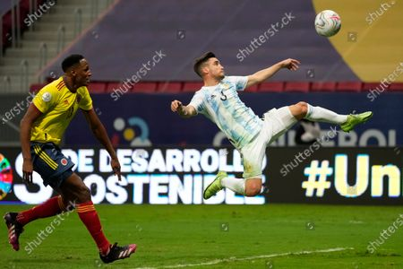 Argentina's Nicolas Tagliafico jumps for the ball followed by Colombia's Yerry Mina during a Copa America semifinal soccer match at the National stadium in Brasilia, Brazil