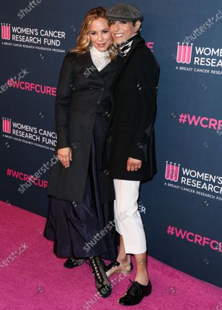 Actress Maria Bello and partner/chef Dominique Crenn arrive at The Women's Cancer Research Fund's An Unforgettable Evening Benefit Gala 2020 held at the Beverly Wilshire, A Four Seasons Hotel on February 27, 2020 in Beverly Hills, Los Angeles, California, United States.