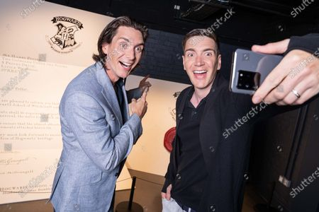 Stock Image of James and Oliver Phelps, the actors who played Fred and George Weasley in the Harry Potter film series, pictured at the launch of The Harry Potter Photographic Exhibition in Covent Garden today, before it officially opens to fans on July 12th