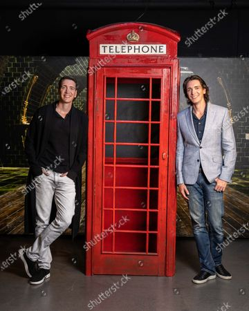 Stock Picture of James and Oliver Phelps, the actors who played Fred and George Weasley in the Harry Potter film series, pictured at the launch of The Harry Potter Photographic Exhibition in Covent Garden today, before it officially opens to fans on July 12th