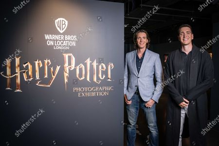 James and Oliver Phelps, the actors who played Fred and George Weasley in the Harry Potter film series, pictured at the launch of The Harry Potter Photographic Exhibition in Covent Garden today, before it officially opens to fans on July 12th