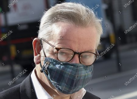 Michael Gove, Minister for the Cabinet Office, glasses steam up as he arrives in Whitehall wearing a face mask. Later the prime minister is expected to announce a final lifting of Covid-19 regulations on July 19th including making the wearing of face masks voluntary.