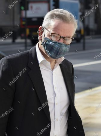Stock Picture of Michael Gove, Minister for the Cabinet Office, glasses steam up as he arrives in Whitehall wearing a face mask. Later the prime minister is expected to announce a final lifting of Covid-19 regulations on July 19th including making the wearing of face masks voluntary.