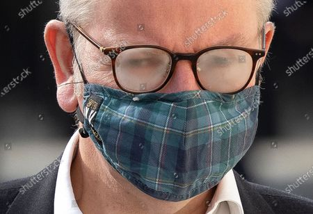 Stock Photo of Michael Gove, Minister for the Cabinet Office, glasses steam up as he arrives in Whitehall wearing a face mask. Later the prime minister is expected to announce a final lifting of Covid-19 regulations on July 19th including making the wearing of face masks voluntary.