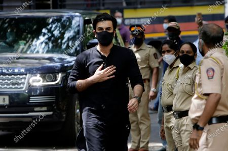 """Bollywood actor Ranbir Kapoor arrives to pay last respects to Bollywood icon Dilip Kumar in Mumbai, India, . Dilip Kumar, hailed as the """"Tragedy King"""" and one of Hindi cinema's greatest actors, died Wednesday in a Mumbai hospital after a prolonged illness. He was 98"""