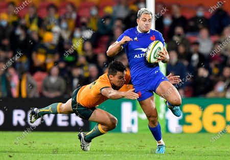 Stock Picture of Arthur Vincent (Rt) of France is tackled by Matt Toomua (L) of the Wallabies during the First Rugby Union Test Match between the Australian Wallabies and France at Suncorp Stadium in Brisbane, Australia, 07 July 2021.