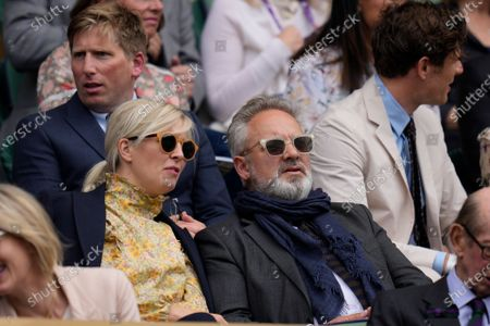 English film and stage director, producer and screenwriter Sam Mendes waits for the start of the match in Centre Court on day nine of the Wimbledon Tennis Championships in London