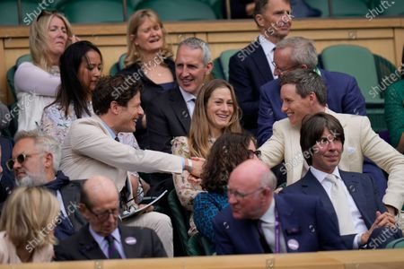 Actors James Norton, left, and Eddie Redmayne, shake hands before the start of the match at Centre Court on day nine of the Wimbledon Tennis Championships in London