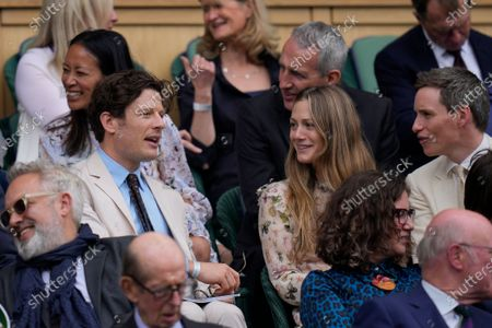 Stock Image of Actors James Norton, left, and Eddie Redmayne, right, wait for the start of the match at Centre Court on day nine of the Wimbledon Tennis Championships in London