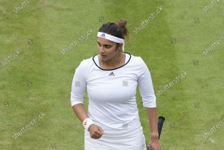 Stock Image of India's Sania Mirza walks on the court during the mixed doubles third round match against Jean-Julien Rojer from the Netherlands and Slovenia's Andreja Klepac on day nine of the Wimbledon Tennis Championships in London