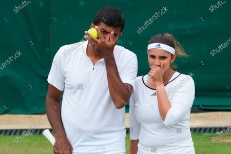 Stock Picture of India's Sania Mirza, right, and Rohan Bopanna encourage each other during the mixed doubles third round match against Jean-Julien Rojer from the Netherlands and Slovenia's Andreja Klepac on day nine of the Wimbledon Tennis Championships in London