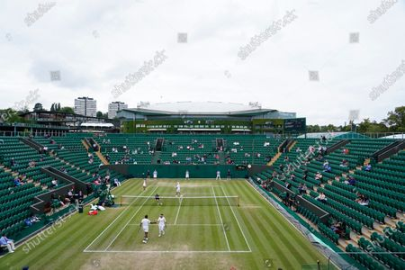 India's Sania Mirza and Rohan Bopanna, front, play the mixed doubles third round match against Jean-Julien Rojer from the Netherlands and Slovenia's Andreja Klepac on day nine of the Wimbledon Tennis Championships in London