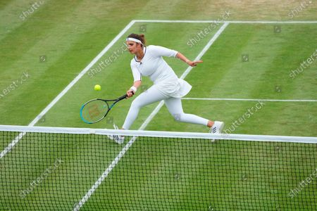 India's Sania Mirza plays during the mixed doubles third round match against Jean-Julien Rojer from the Netherlands and Slovenia's Andreja Klepac on day nine of the Wimbledon Tennis Championships in London