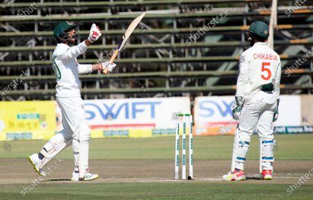 Bangladesh batsman Mohammad Mahmudullah, left, celebrates scoring 100 runs on the second day of the test cricket match between Zimbabwe and Bangladesh at Harare Sports Club in Harare
