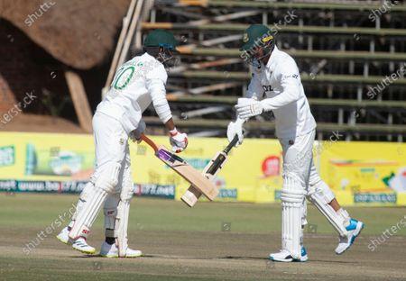 Bangladesh batsman Mohammad Mahmudullah, left, greets fellow batsman Taskin Ahmed on the second day of the test cricket match between Zimbabwe and Bangladesh at Harare Sports Club in Harare