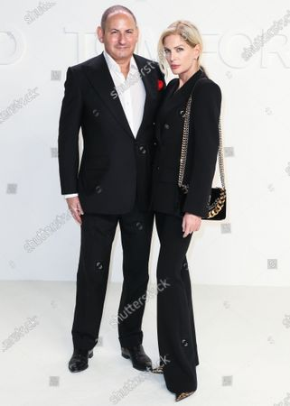Stock Photo of John Demsey and Priscilla Phillips arrive at the Tom Ford: Autumn/Winter 2020 Fashion Show held at Milk Studios on February 7, 2020 in Hollywood, Los Angeles, California, United States.