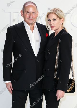 John Demsey and Priscilla Phillips arrive at the Tom Ford: Autumn/Winter 2020 Fashion Show held at Milk Studios on February 7, 2020 in Hollywood, Los Angeles, California, United States.