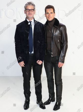 Simon Halls and Matt Bomer arrive at the Tom Ford: Autumn/Winter 2020 Fashion Show held at Milk Studios on February 7, 2020 in Hollywood, Los Angeles, California, United States.