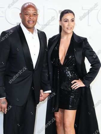 Dr. Dre and Nicole Threatt arrive at the Tom Ford: Autumn/Winter 2020 Fashion Show held at Milk Studios on February 7, 2020 in Hollywood, Los Angeles, California, United States.