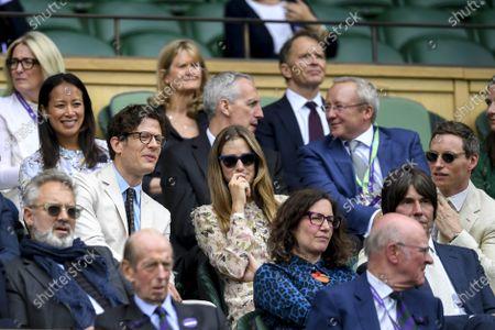 British actors James Norton (C-L) and Eddie Redmayne (R) watch a men's quarter final match between Novak Djokovic of Serbia and Marton Fucsovics of Hungary at the Wimbledon Championships, Wimbledon, Britain, 07 July 2021.